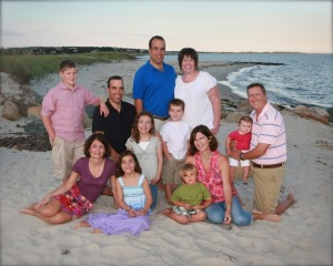A family wearing a wide variety of colors for their family portrait.